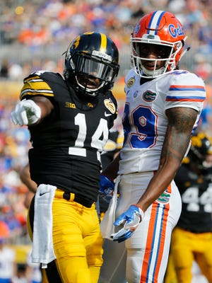 Jan 2, 2017; Tampa, FL, USA; Iowa defensive back Desmond King and Florida receiver Tyrie Cleveland discuss a play in the second half at Raymond James Stadium.