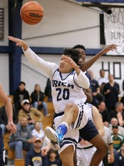 Cathedral's Alex Hernandez has his shot blocked by