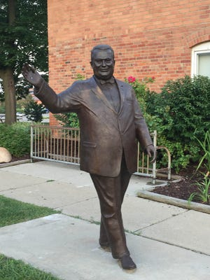 The Orville Hubbard statue was moved to another new location: the side of the McFadden Ross instead of right in front of the building on Brady Street. It was photographed on August 2, 2017.