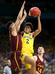 Michigan guard Jordan Poole is defended by Loyola-Chicago