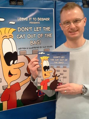 """Clay Boura is the author of a children's book, """"Leave It To Beamer Presents: Don't Let the the Cat Out of the Bag!"""" The Web designer published the book himself to realize a dream of becoming an author."""