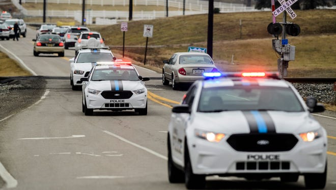 Police block off a section of W. Boonville-New Harmony Road after finding a suspect, who was connected to two fatal shootings, deceased in his vehicle at the Vanderburgh 4-H Center early Sunday afternoon. Authorities believe the two victims and the suspect knew each other prior to the fatal shootings.