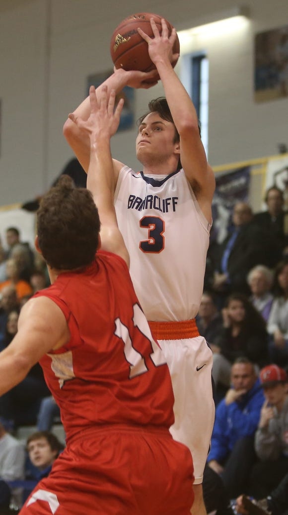 Briarcliff's Jack Ryan (3) puts up a shot in front