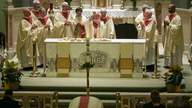 Delaware Bishop Francis Malooly says pastors and parishioners should use common sense about touching during flu season.