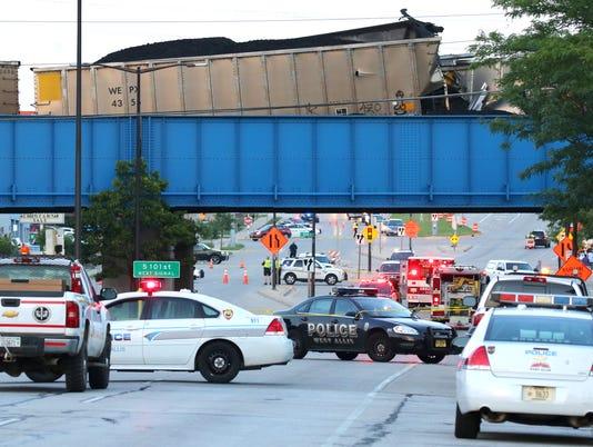 Train derailment closes Greenfield Avenue