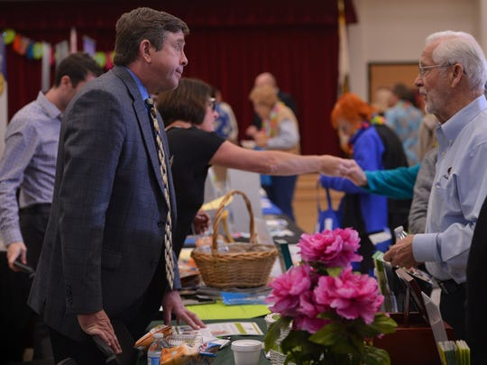 Scott Stane (left), with Smart Cremation, and George Jones, with Home Helpers Caregivers, chat Wednesday at the 2017 Wellness Fest, held at the Goebel Adult Community Center in Thousand Oaks.
