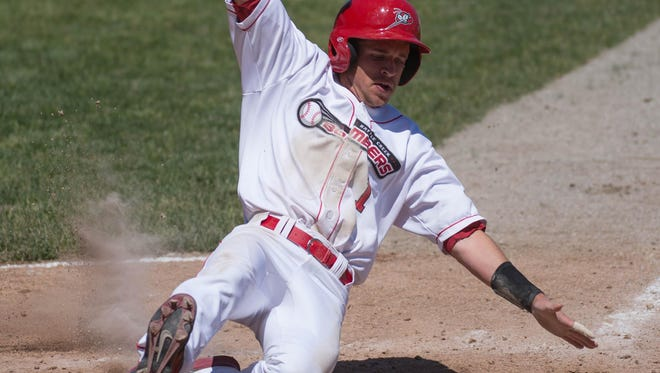 Bombers' Trek Stemp slides into home during Tuesday's game.