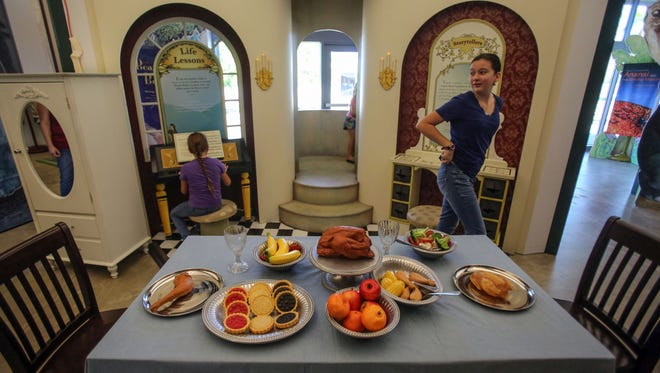 """Mikaela Ramirez-Younger, 8, and her sister Andrea Ramirez-Younger, 11, play in the """"Beauty and the Beast"""" section of the Children's Discovery Museum of the Desert's new traveling exhibit 'Once Upon a Time...Exploring the World of Fairy Tales' on Saturday, September 30, 2017, in Rancho Mirage."""
