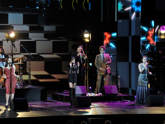 Members of Scott Bradlee & Postmodern Jukebox perform