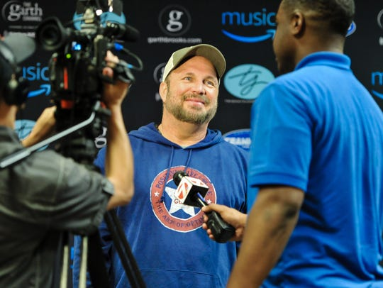 Garth Brooks speaks with media before his concert at