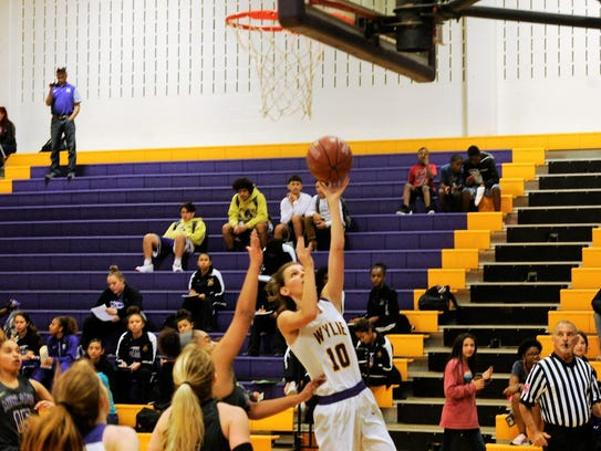 Wylie's Abbey Henson goes in for a lay up against Midland