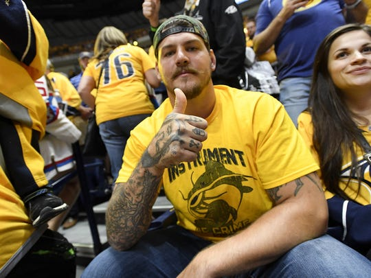 Titans tackle Taylor Lewan shows support for the Predators before Game 3 in the Stanley Cup Final at Bridgestone Arena in June 2017.