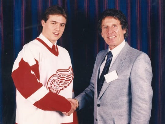 A young Steve Yzerman and Red Wings owner Mike Ilitch