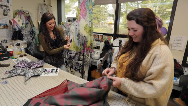 Gabrielle Amaturo, left, and Allison Carolei, seniors in the Fashion Design program at Marist College in Poughkeepsie, work in the fashion lab April 12, 2018. The two will be part of the school's annual Silver Needle Runway and Awards at the Mid-Hudson Civic Center in Poughkeepsie on May 4th.
