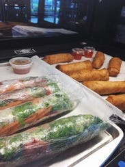 Fresh egg rolls and spring rolls are served at The
