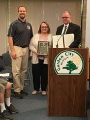 Darlene Hennessy (center) with Garden City Parks and