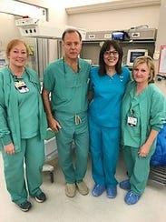 Dr. de Soler with the staff at Glenwood Medical Center