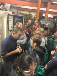 Students tour E&E Manufacturing of Plymouth.