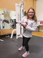 Jenna Kanfer works on improving her upper body strength