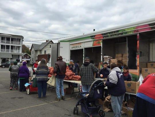 Volunteers help Binghamton families stock up on food