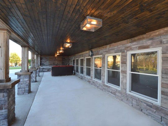 Both the upper and lower deck are surrounded by extensive rock work and reclaimed wood.