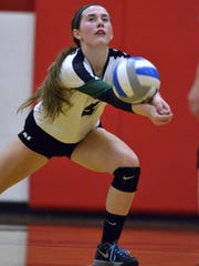 Novi libero Claire Pinkerton stays focused on the ball Tuesday against Canton.