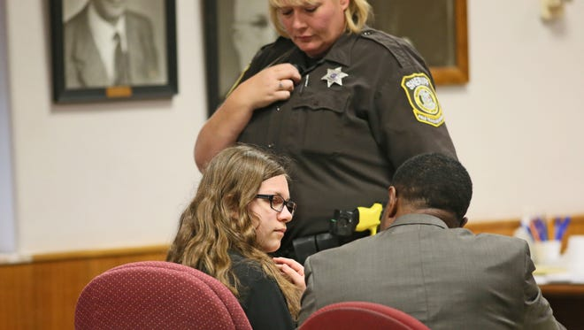 Anissa Weier (left), with her attorney Joseph Smith, entered a plea of not guilty by reason of mental disease or defect to the accusation of stabbing another girl in Waukesha.