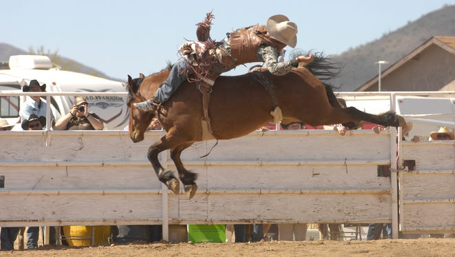 During the Cave Creek Fiesta Days Rodeo, cowboys and cowgirls compete for prize money and buckles.