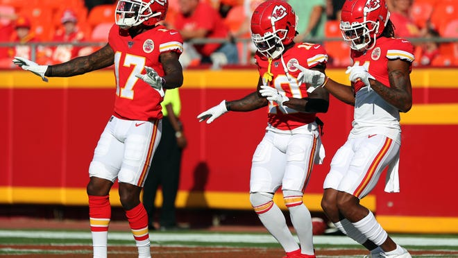 Kansas City Chiefs wide receivers Mecole Hardman (17), Tyreek Hill (10) and Demarcus Robinson (11) dance during warmups before a game last season. Hill defeated Hardman in a race in camp recently, but all of the Chiefs receivers have displayed their world class speed.