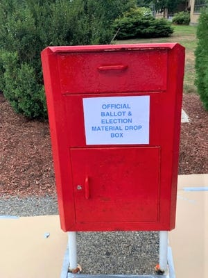 Police security cameras are watching Grafton's red ballot box outside the municipal center.