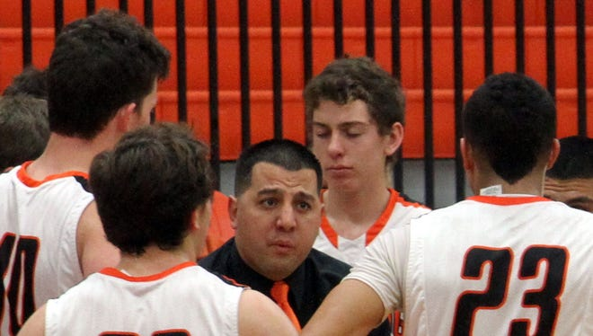 Artesia coach Michael Mondragon talks to his team during a timeout in the second quarter Saturday, Dec. 13, 2014. Mondragon is back for his second year at the helm.