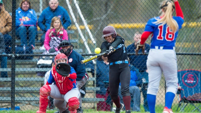 Okemos junior Kate Buckland makes contact during a game last month. Buckland recently verbally committed to Mercer.