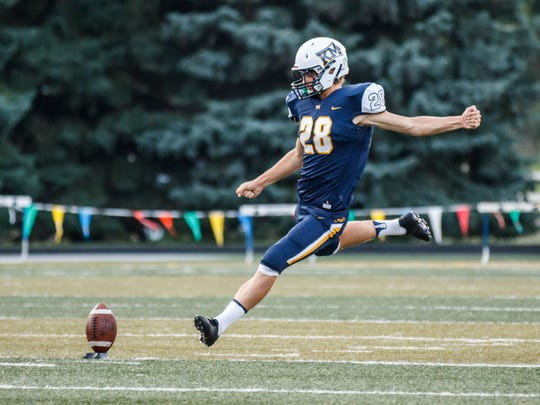 Kettle Moraine kicker Blake Wilcox (28) sends one downfield