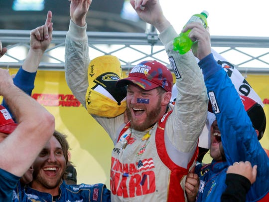 Sprint Cup Series driver Dale Earnhardt Jr. (88) celebrates winning the Goody's Headache Relief Shot 500 at Martinsville Speedway.