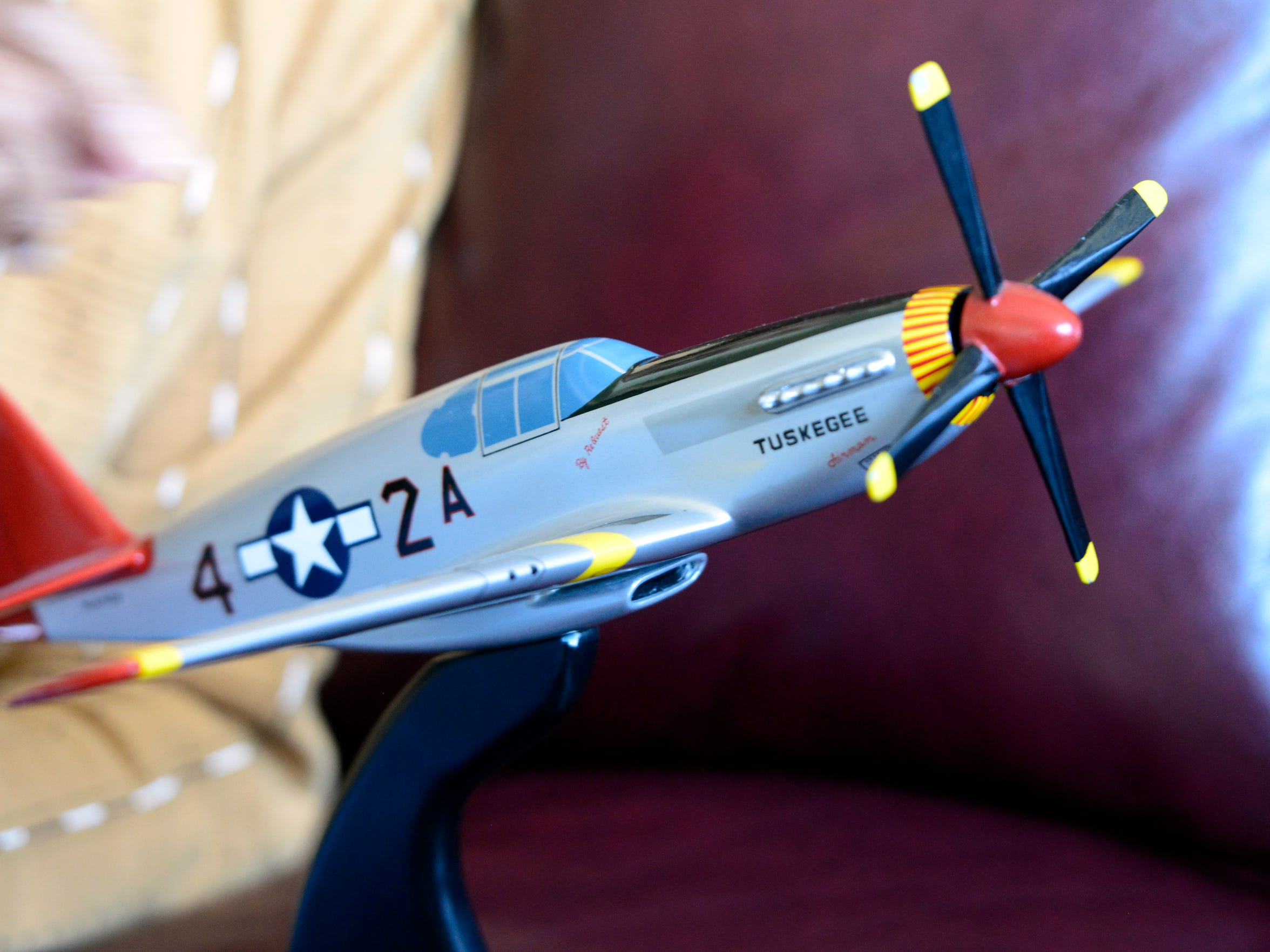 Harold H. Brown shows a model of the P-51 C Mustang,