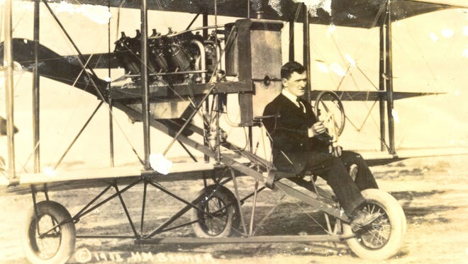 Lincoln Beachey sits in his flying machine in 1912.