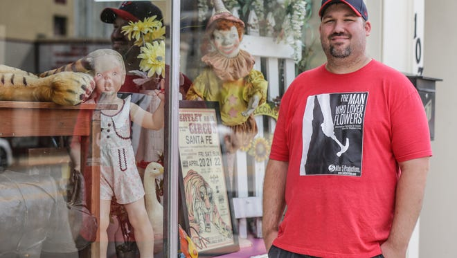 """Five after Five Productions Director Cameron Grimm stands along Main St. in Greenfield where his newest project """"The Man Who Loved Flowers"""" will film,  Wednesday, August 30, 2017. The film which will begin production in September is based on a short story by Stephen King."""