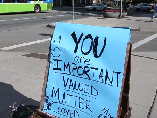 A sandwich board advertised Bridget Strub's message of kindness following a divisive election.