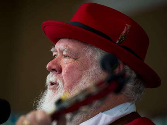 "Joe Pack plays guitar and sings while performing ""White Christmas"" with musical group Shade Tree Players at Christmas in New Harmony, Ind., on Saturday, Dec. 2, 2017. The annual event included a craft market, musical performances, open houses at local merchants, and photos with Santa."