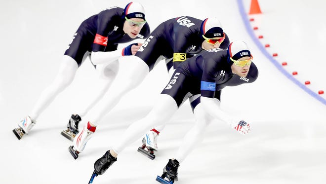 Joey Mantia, Emery Lehman and Brian Hansen of the U.S. skate in the men's team pursuit at the Gangneung Oval.