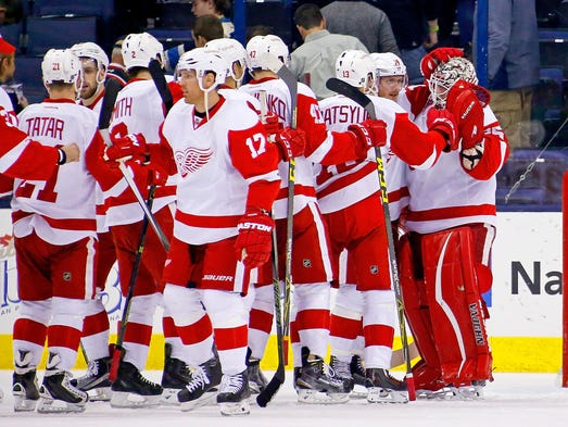 Red Wings goalie Jimmy Howard is congratulated by his