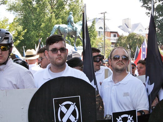 James Alex Fields Jr., second from left, holds a black