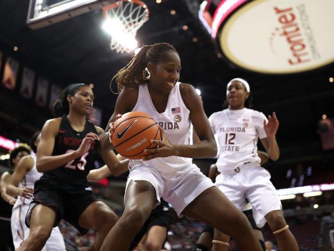 FSU's Ama Degbeon grabs a rebound on the baseline against