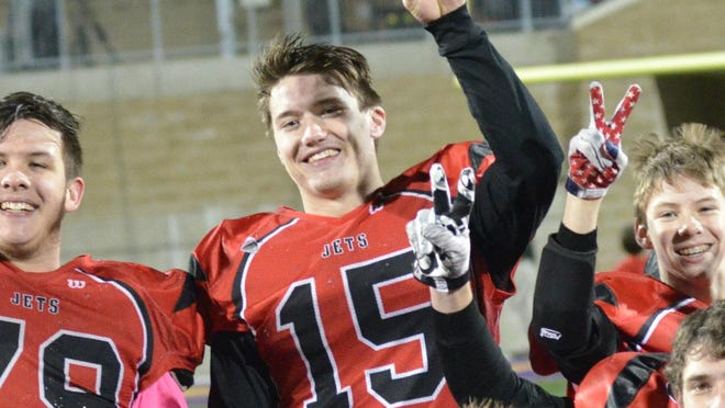 Powers North Central quarterback Jason Whitens celebrates the Jets' second-straight 8-man football state championship following a 58-22 win over Deckerville at Greenville High School on Friday, Nov. 18, 2016.