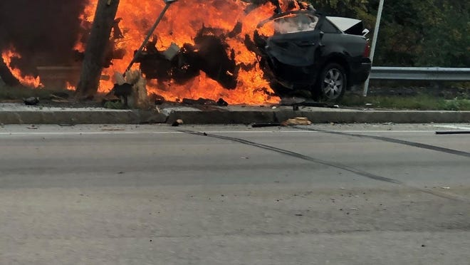 A Ford 500 sedan burst into flames after striking a utility pole on Route 138 in Raynham following a state police pursuit, Tuesday, Sept. 29, 2020.