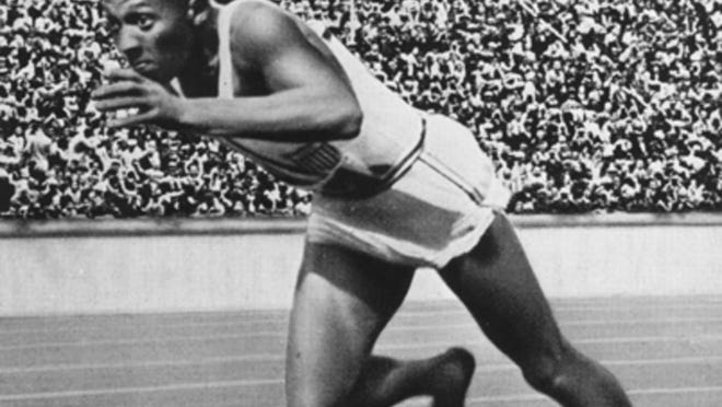 Jesse Owens competing at the 1936 Olympics in Berlin, where he won four gold medals.