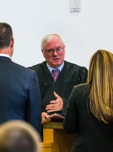 At a hearing Tuesday, Maricopa County Superior Court Judge Warren J. Granville unsealed documents in the Phoenix freeway shooting case. Attorneys meet Granville (center) to discuss the unsealing of court documents, Tuesday, May 10, 2016, in Phoenix.