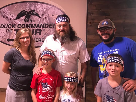 Duck Commander CEO Willie Robertson poses with fans