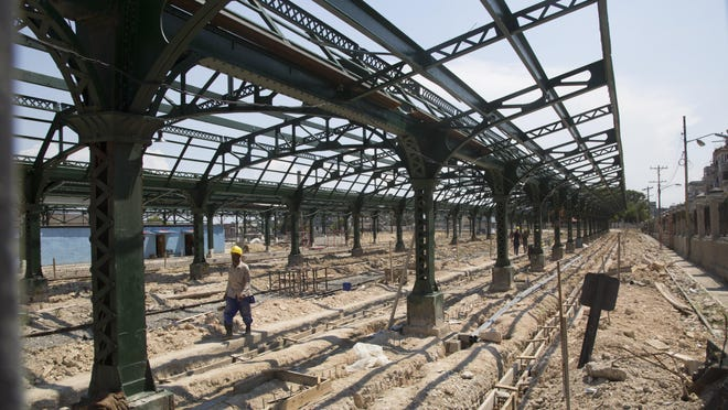 Workers rebuild and refurbish the central station in Havana, Cuba, Wednesday, May 22, 2019.