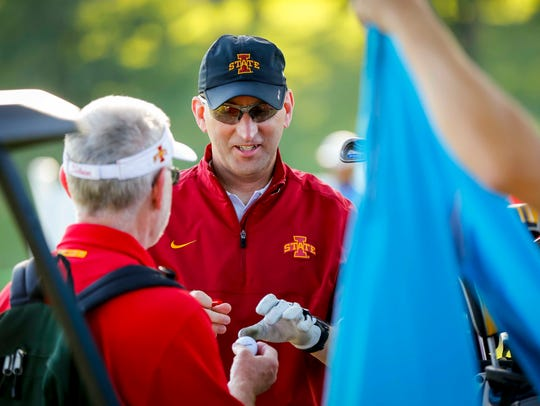 Iowa State Director of Athletics Jamie Pollard signs